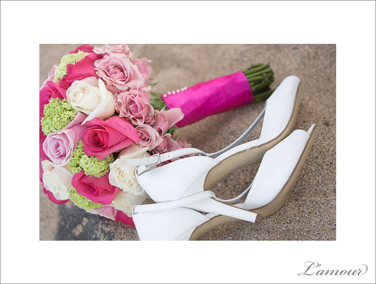 Fuscia Magenta Pink White and Green Wedding bouquet in the sand