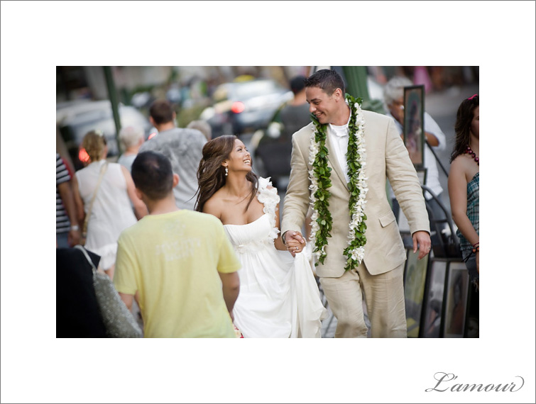 Bride and Groom walking down Waikiki in Hawaii to their Reception