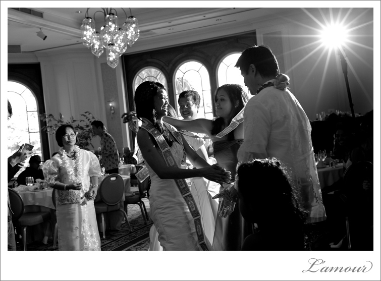 Hawaii Wedding Photographer L'Amour shot this Money Dance at the Moana Surfrider in Honolulu