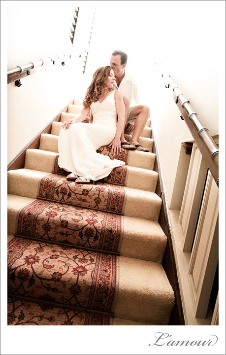 Hawaii destination wedding Bride and Groom sit posed on a staircase