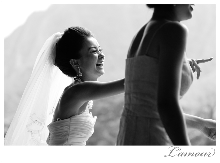 Black and White wedding photo of bride having fun