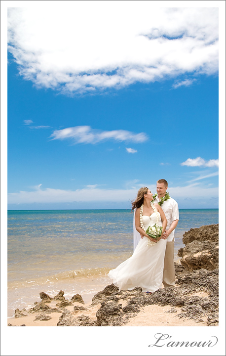 Bride and groom on the beach at their hawaii destination wedding