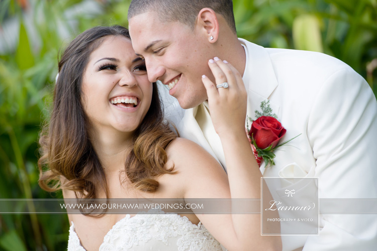 Hawaii Bride and Groom laugh on their red themed wedding day on Oahu