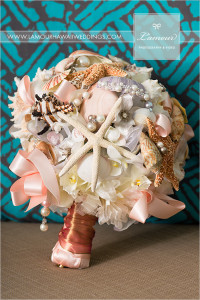 Beach wedding bouquet with pink ribbons, shells, and storfish. mermaid bouquet