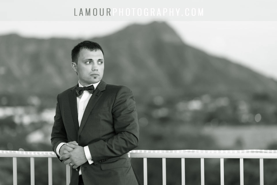 Destination wedding groom with diamond head in background at Waikiki wedding at Tiki's Grill and Bar Coconut Club