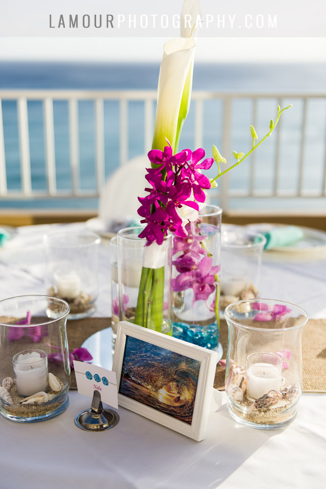 Hawaii wedding table setting with purple orchids at Oahu wedding at Tiki's Grill and Bar in Waikiki