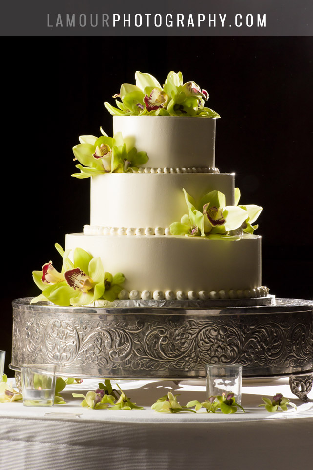 Hawaii wedding cake white buttercream round three tier with green orchids