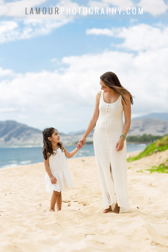 Family portraits on the beach on Oahu Hawaii with mother and daughter in white bohemian dresses