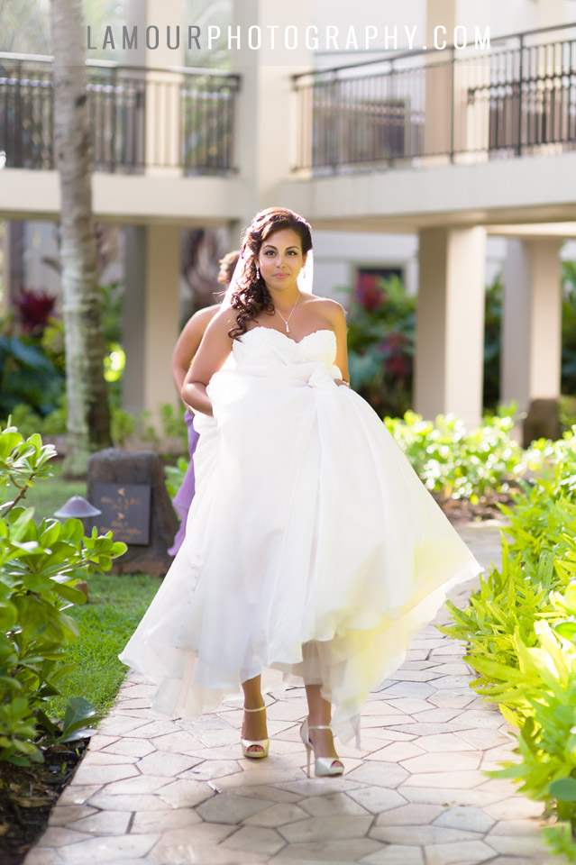 Bride walking down aisle at turtle Bay resort wedding on Oahu with photography and video by L'Amour