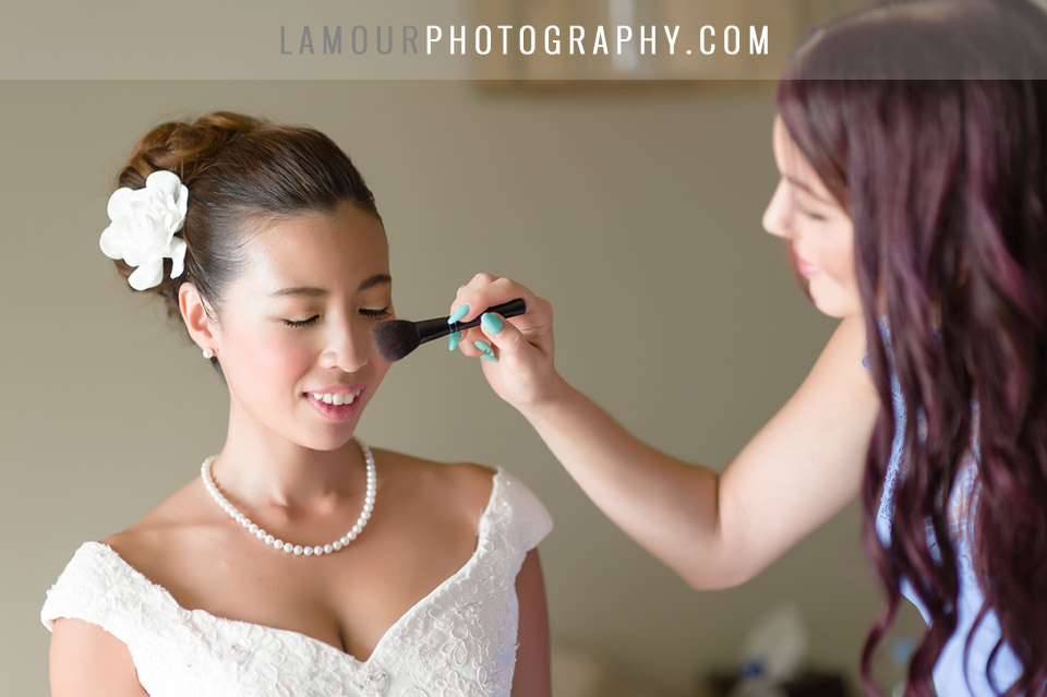 Bride gets hair and makeup done at Turtle Bay Resort for her Hawaii Wedding