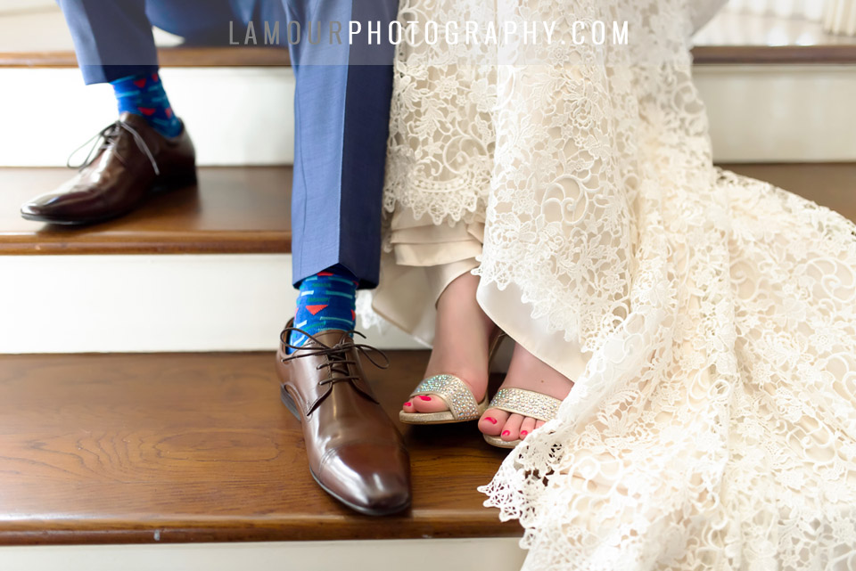 blue suit and lace dress with sparkly shoes and patterned socks at destination wedding in Hawaii