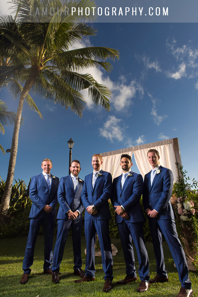 groomsmen at hawaii wedding in blue suits at Moana Surfrider