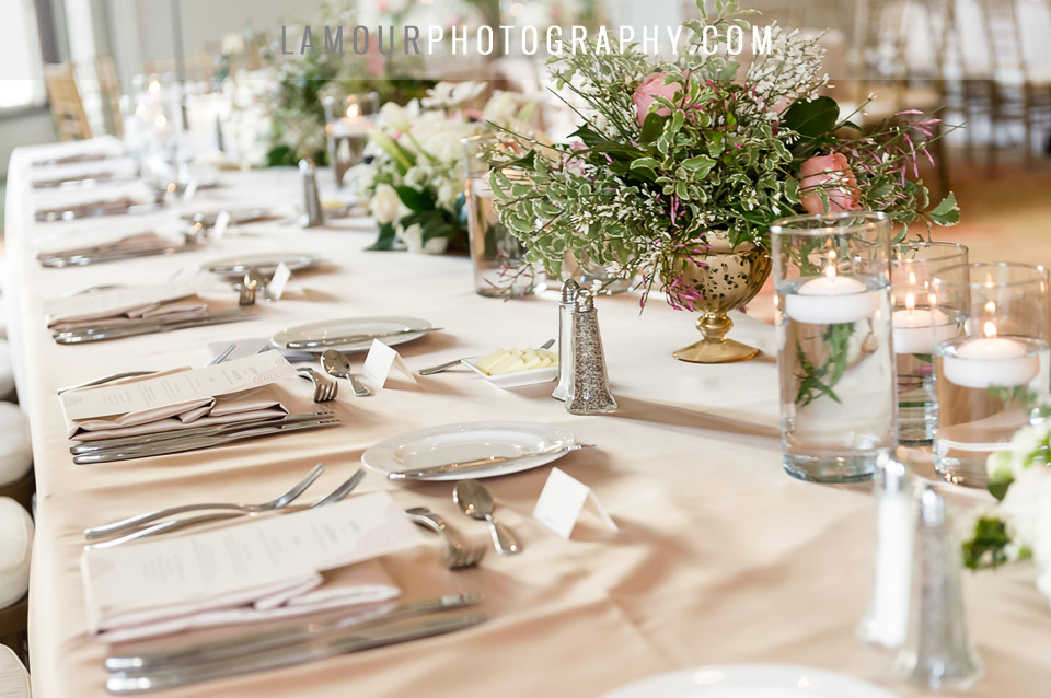 hawaii wedding reception table with floating candles blush pink and gold at the Moana Surfrider
