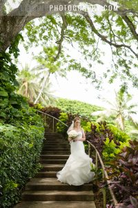 Bride arriving at wedding ceremony venue at Kualoa Ranch