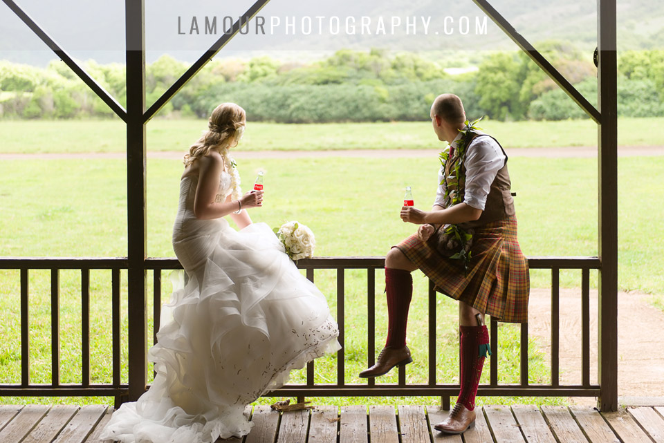 Bride and Groom in Kilt enjoy wedding ceremony and reception at Kualoa Ranch on Oahu