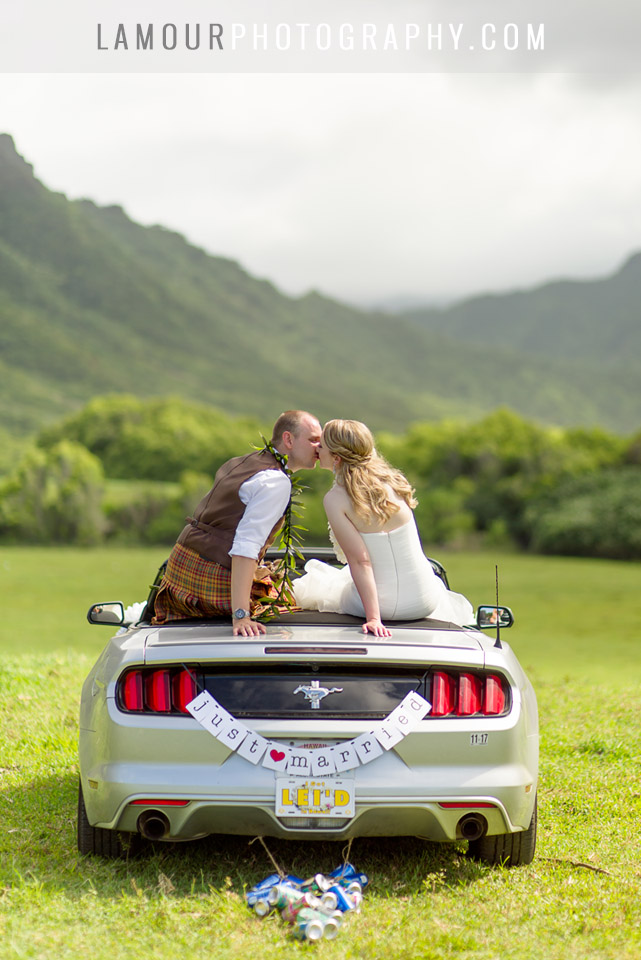 Heading off in a convertible mustang at Kualoa Ranch for this hawaii wedding
