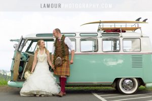 Volkswagon van with surfboards takes Hawaii wedding couple to ceremony on Oahu