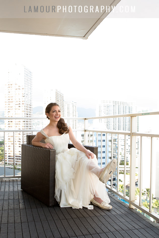 waikiki beach wedding bride laughs while getting ready in honolulu