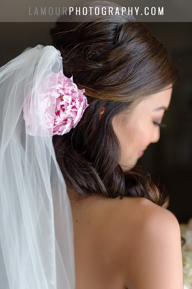 hawaii wedding bride wears pink flower in her hair for ceremony at turtle bay