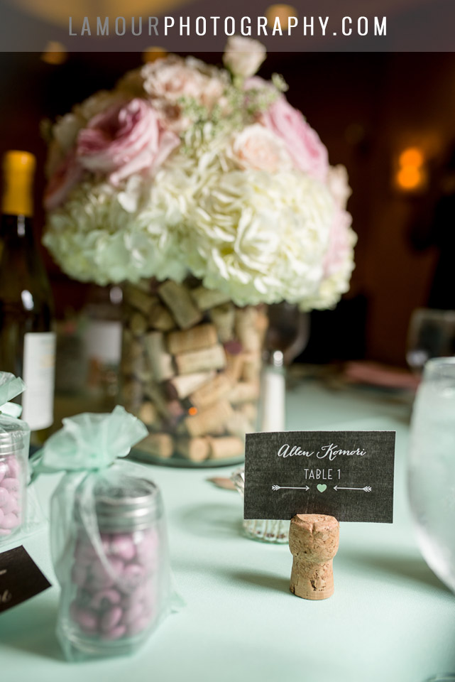 pastel green and pink wedding theme with wine cork place card