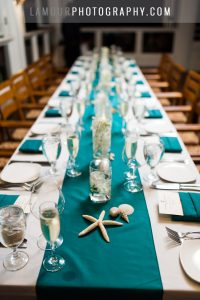 teal turquoise beach themed wedding reception table in hawaii