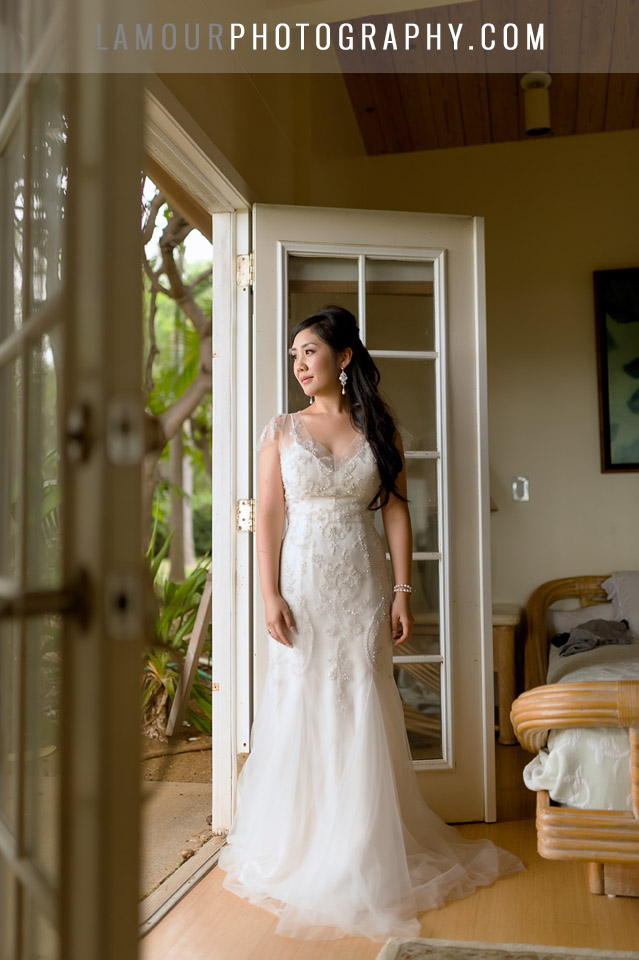 hawaii beach wedding bride looks out window before ceremony