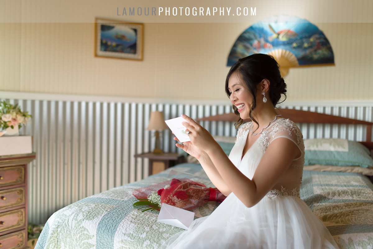 Happy bride opens card before maui wedding ceremony photo and video