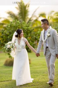 Hawaii bride and groom walk in destination wedding in maui