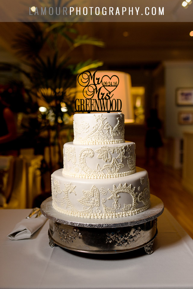 white wedding cake with lace decorations
