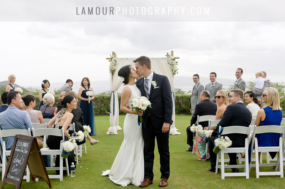 Destination wedding couple shares a kiss after saying I do in Maui Hawaii