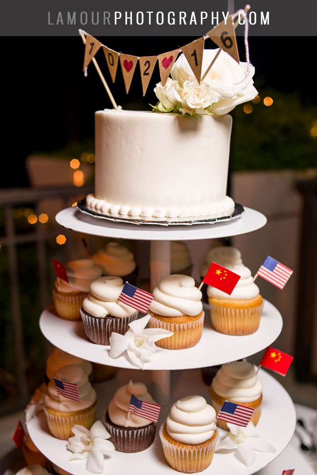 hawaii wedding cake with cupcakes and pendant sign on top
