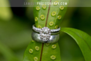 Oahu wedding rings with oval diamond and halo