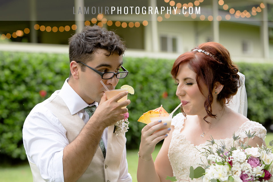 Hawaii wedding bride and groom sip mai tais during their cocktail hour
