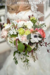 Wedding bouquet for oahu with wedding ceremony in Hawaii with roses, peonies and black center anemones