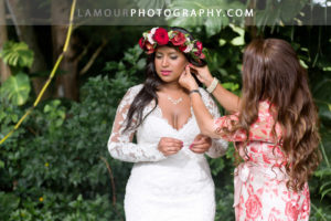 Hawaii bride gets ready in her lace wedding dress with long sleeves