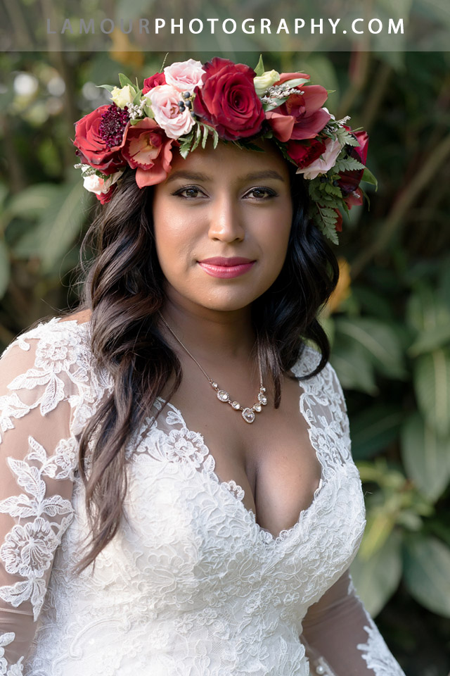 Kualoa Ranch bride wears a red flower crown or haku for her wedding on oahu