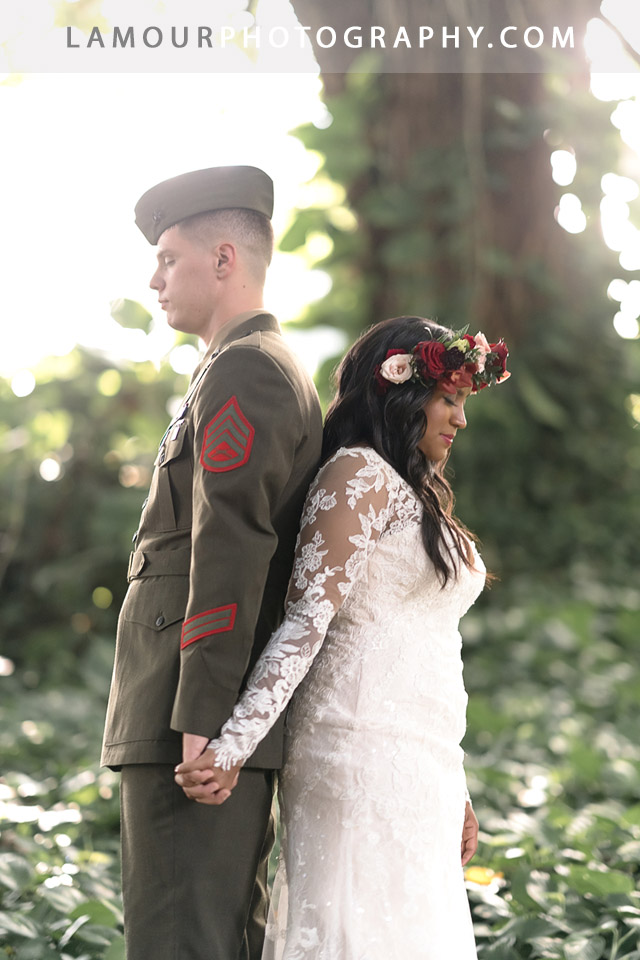 bride and groom keep from looking at each other but hold hands before wedding ceremony in Hawaii