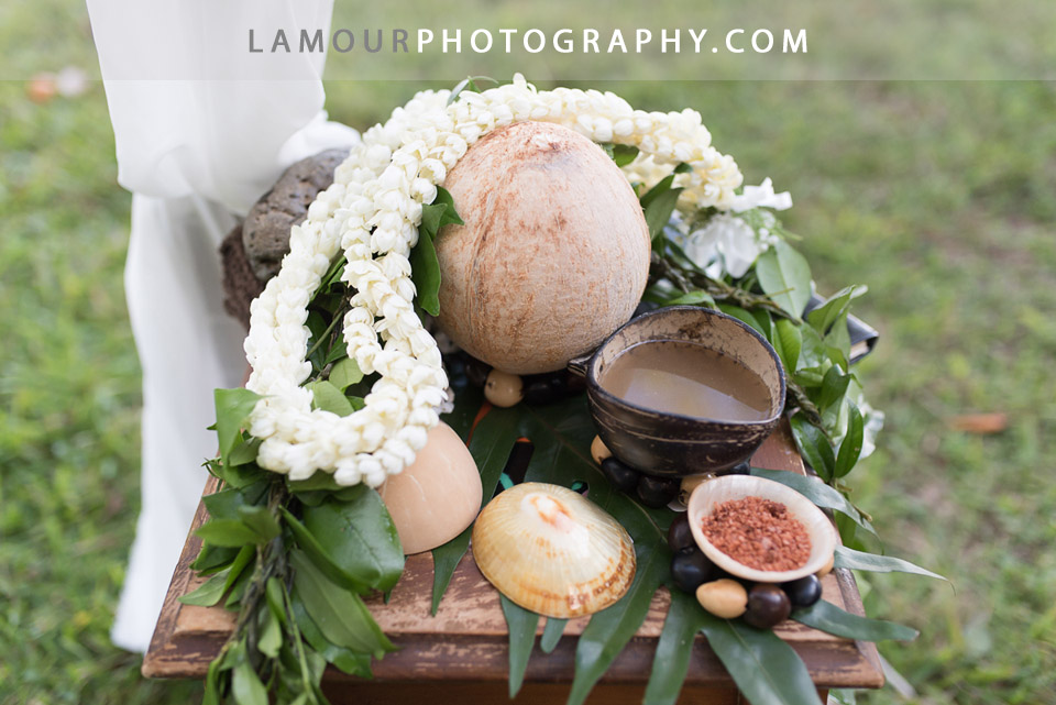 Hawaii wedding ceremony with flower lei and coconuts for Kualoa Ranch wedding on Oahu