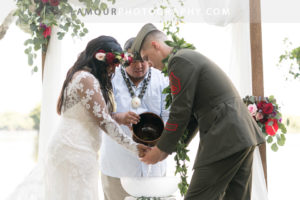 Bride and groom during Hawaii wedding ceremony at Kualoa Ranch