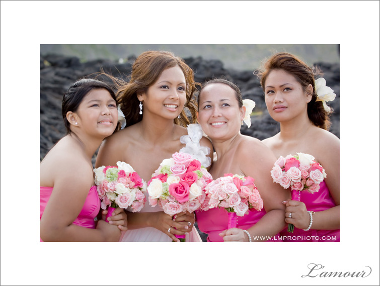 Bridesmaids in Fuscia dresses with Bride taken at Makapuu Beach on Oahu by L'Amour Photographers