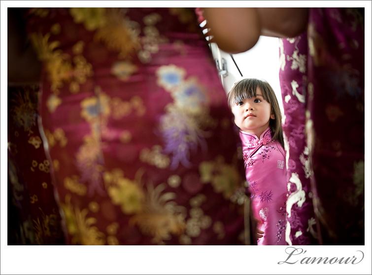 Flower Girl looks up at Bridesmaids before Hawaii Wedding