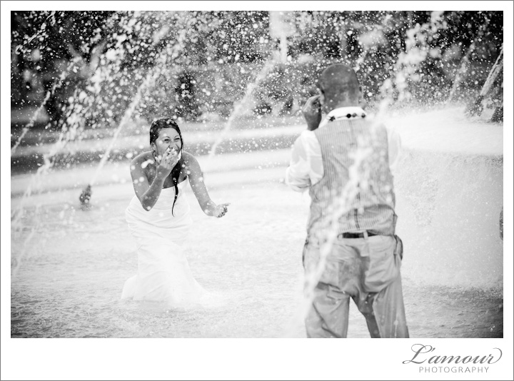 Trash the Dress in the fountain by L'Amour Hawaii Wedding Photography