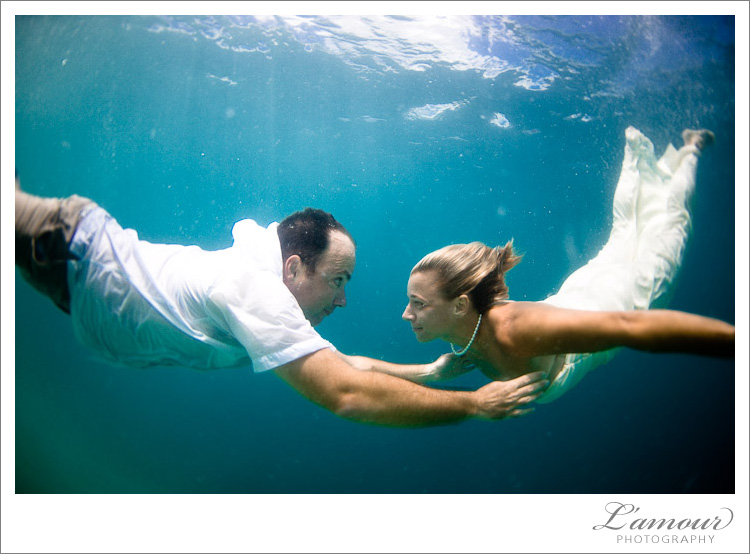 Trash the Dress Photos underwater in Oahu