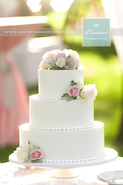 white buttercream wedding cake in hawaii wedding