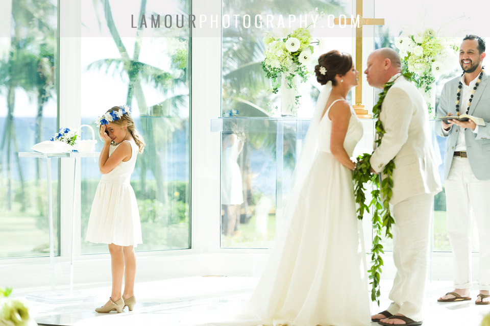 KOolina crystal Chapel wedding in Hawaii flower girl during first kiss at ceremony in Oahu