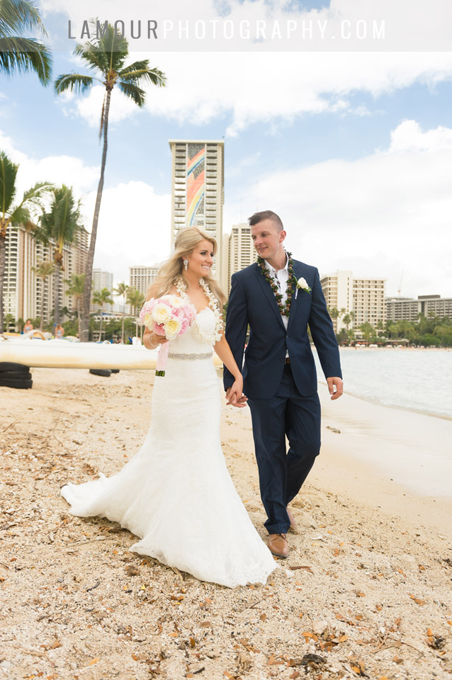 Bride and groom married in waikiki beach at Hilton Hawaiian Village photos by L'Amour