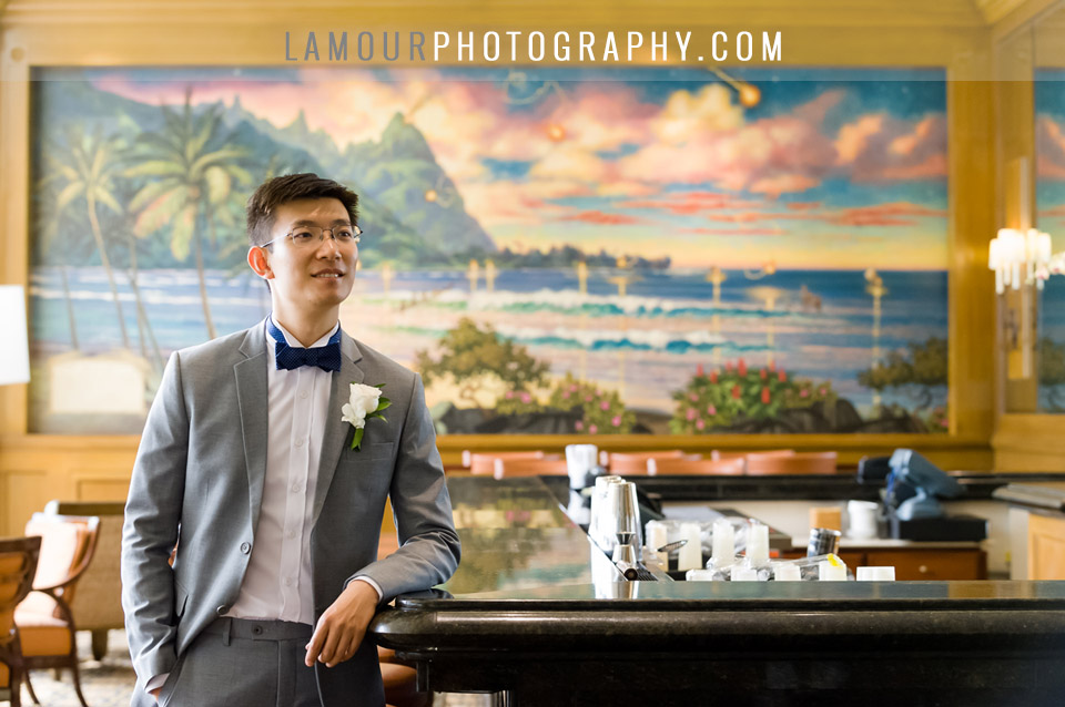 Wedding photo in Hawaii of groom at the St Regis in Kauai looking dapper at the bar