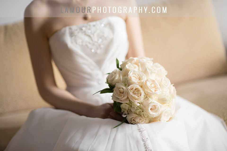 bride with all white roses bouquet at her Hawaii wedding in Kauai