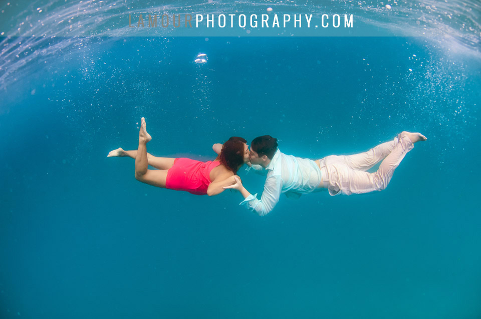 Underwater photo of bride and groom after Hawaii wedding on Oahu by L'amour photography and video