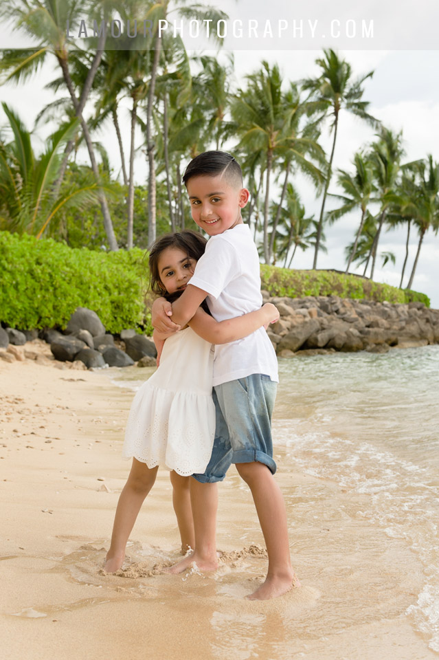 cute kids at family portraits on the beach in Hawaii by L'Amour